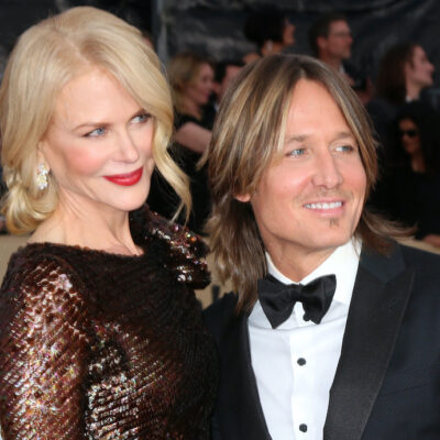 Nicole Kidman in a dress smiling with Keith Urban in a tux