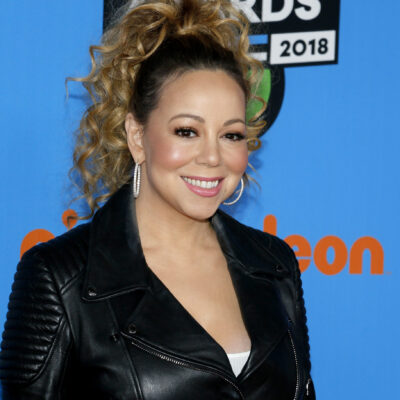 Mariah Carey in a black jacket and high, curly pony at a Nickelodeon event.