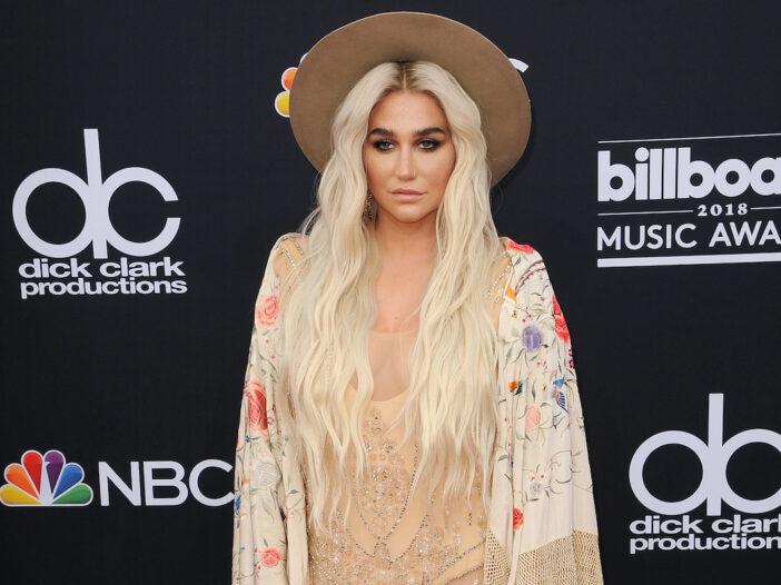 Kesha in a tan dress and hat