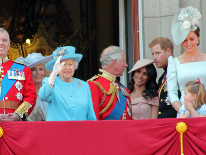 the royal family standing on a balcony
