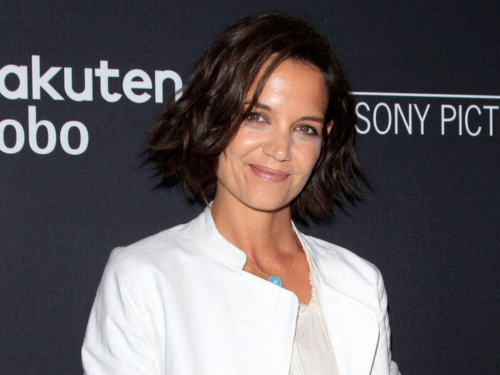 Katie Holmes smiling in a white dress