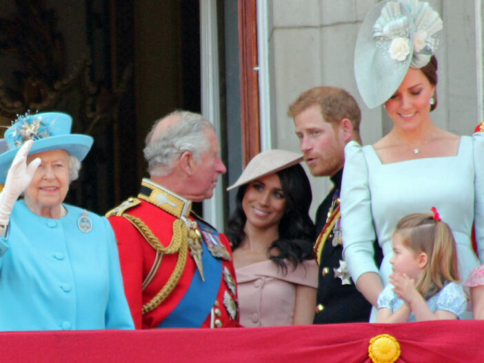 royal family standing on a balcony, Prince Harry and Meghan Markle in the center