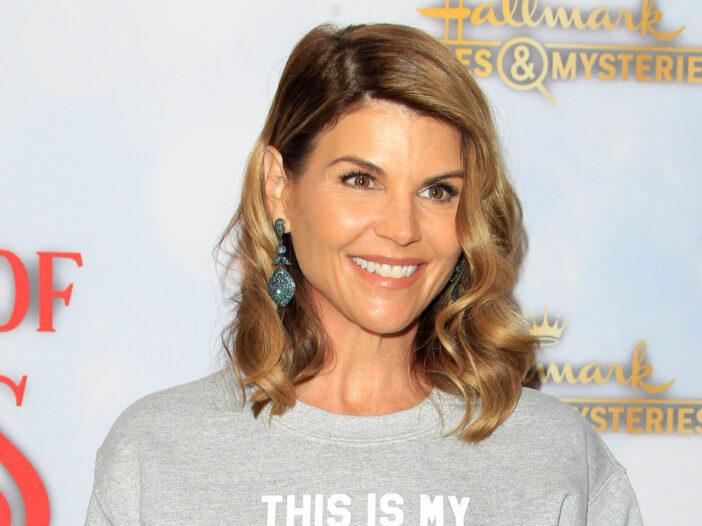 Lori Loughlin smiles in a grey sweater