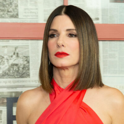 Sandra Bullock in a red dress with red lipstick