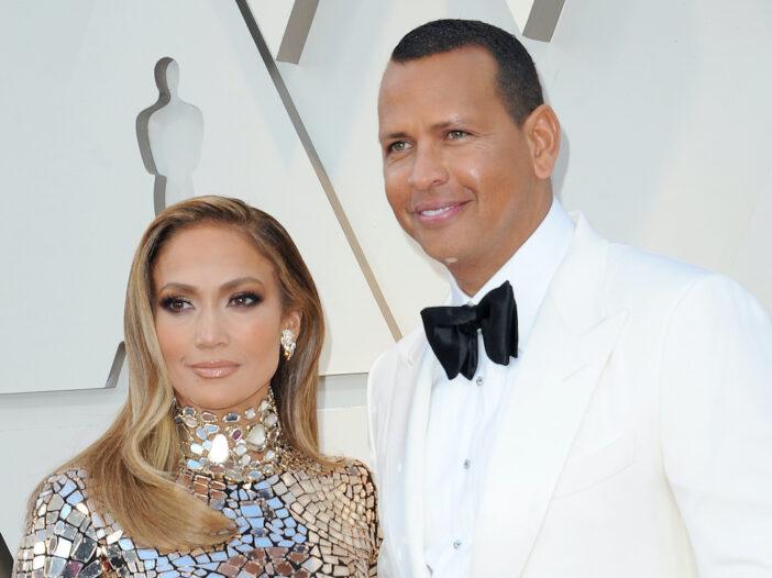 Jennifer Lopez in a shiny dress with Alex Rodriguez in a tux