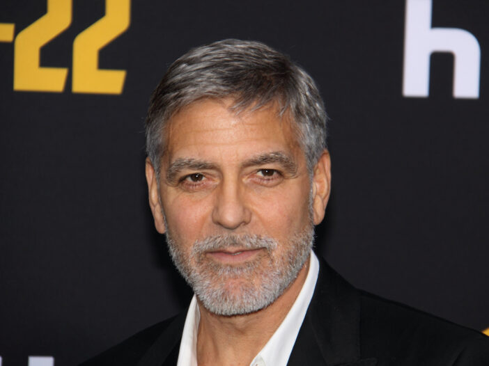 headshot of George Clooney in a suit