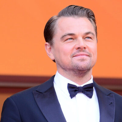 Leonardo DiCaprio smiling in a tuxedo