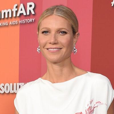 Gwyneth Paltrow smiles in a white dress
