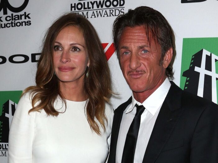 Julia Roberts in a white dress with Sean Penn in a suit