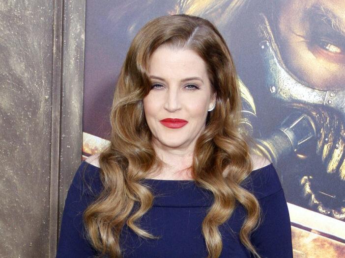 Lisa Marie Presley smiling in a blue dress
