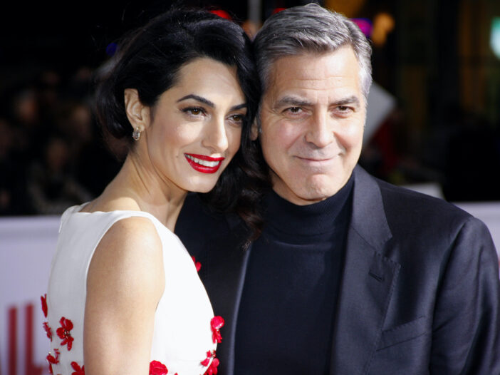 George and Amal Clooney smiling together