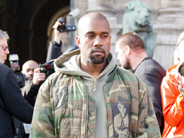 Kanye West in a camo jacket