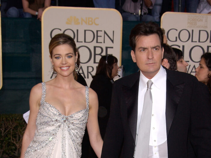 Denise Richards in a white gown and Charlie Sheen in a black suit at the 62nd Annual Golden Globe Awards.