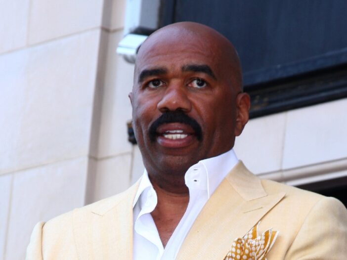 Steve Harvey wears a yellow suit as he attends his Hollywood Walk Of Fame ceremony