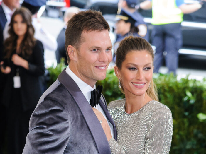 Tom Brady on the left with his arm around Gisele Bunchen