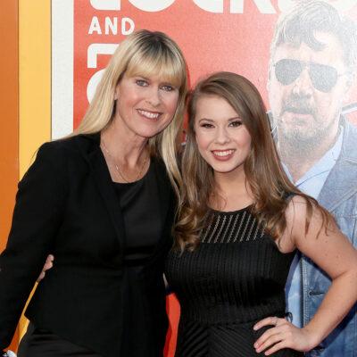 Terri Irwin (right) standing with Bindi Irwin, both wearing black,