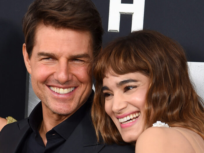 Close up of Tom Cruise on the left and Sofia Boutella on the right, looking cozy