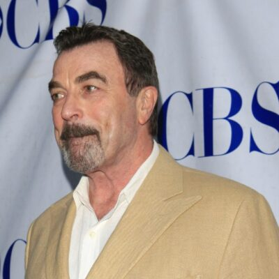 Tom Selleck wears a beige suit to a Blue Bloods event