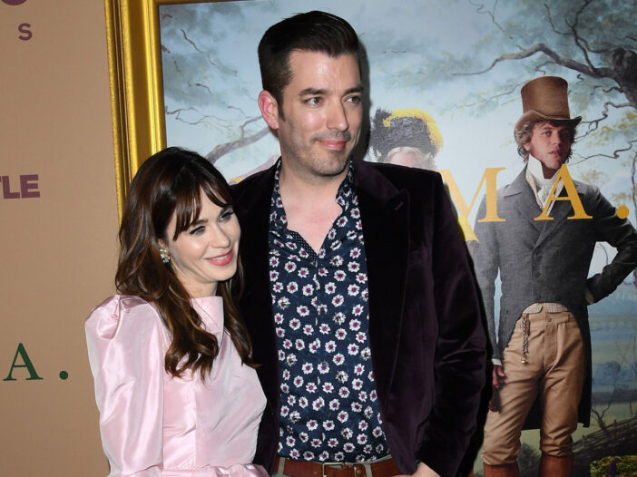 Zooey Deschanel and Jonathan Scott standing with each other at a movie premiere