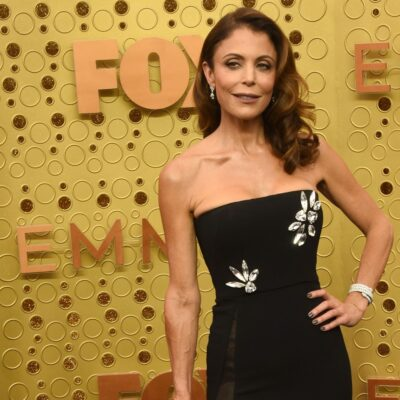 Bethenny Frankel posing in a black dress with her hand on her hip.