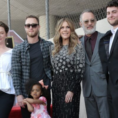 Tom Hanks and Rita Wilson at the Rita Wilson star ceremony. They are posing for a group picture with their grandchild and their kids, Elizabeth Ann Hanks, Chet Hanks, and Truman Hanks.