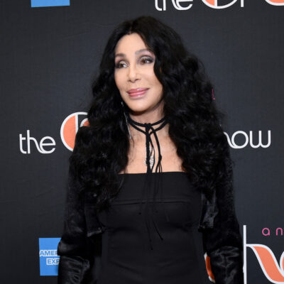 Cher in a black outfit