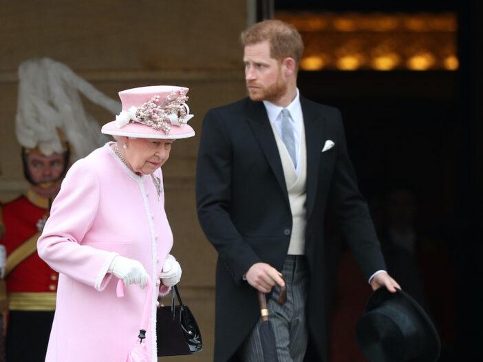 Queen Elizabeth walking with Prince Harry