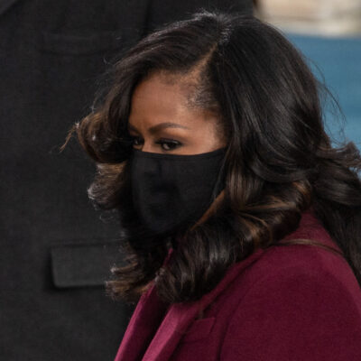 Michelle Obama in a mask and jacket at the Inauguration