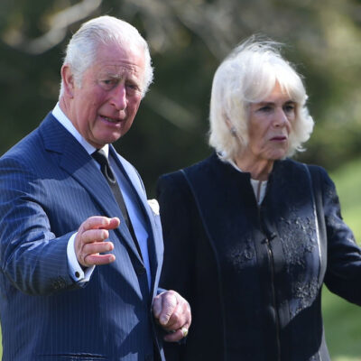 Prince Charles in a blue suit with Camilla Parker Bowles in a black jacket