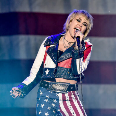 Miley Cyrus singing on stage