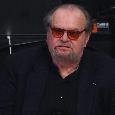 Jack Nicholson after biting a burger courtside