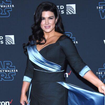 Gina Carano wearing a blue dress.