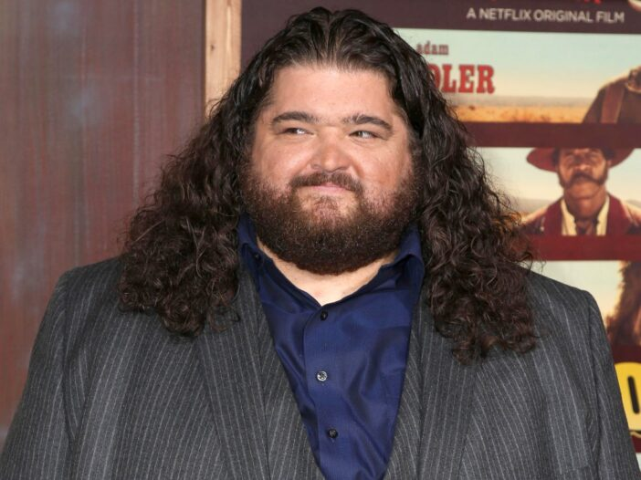 Jorge Garcia in a grey suit with a blue shirt.