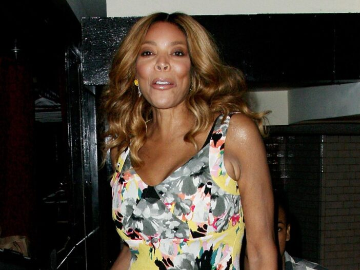 Wendy Williams wears an eccentric print dress as she arrives at an event