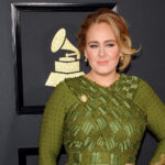 Adele at the Grammys in a green dress.