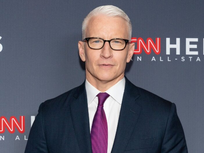 Anderson Cooper wears a dark suit and maroon tie to a CNN Heroes Award Show