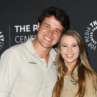 Bindi Irwin on the right, smiling and standing the Chandler Powell