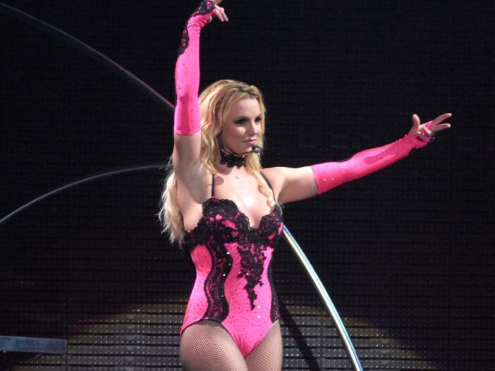 Britney Spears wears a pink leotard as she performs on stage in Rio de Janeiro, Brazil