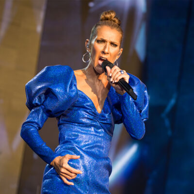 Celine Dion performing in a blue dress.