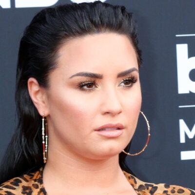 Demi Lovato wears a leopard print blazer to the Billboard Music Awards