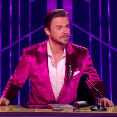 screenshot of Derek Hough in a purple suit on Dancing with the Stars