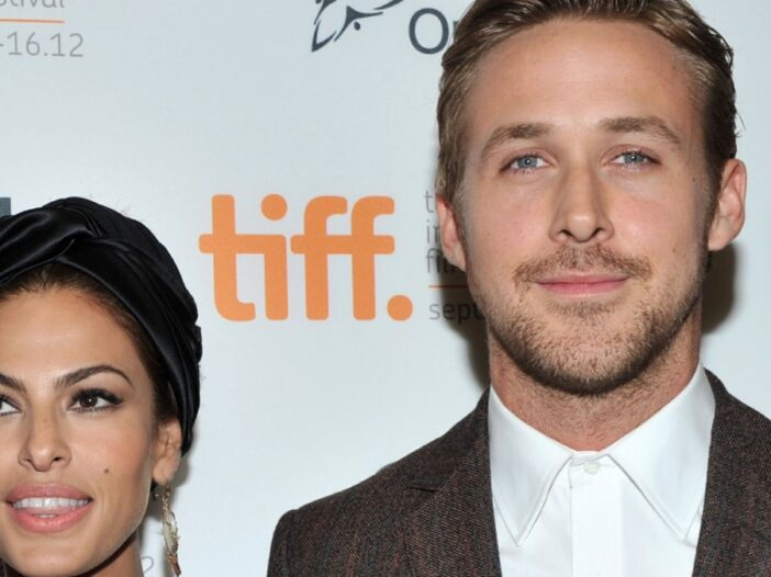 Eva Mendes and Ryan Gosling stand together on the red carpet