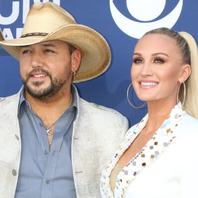 Jason Aldean and his wife Brittany at a red carpet event.