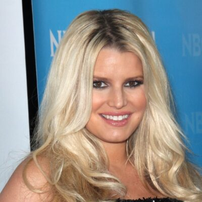Jessica Simpson wears a black, sparkly dress on the red carpet