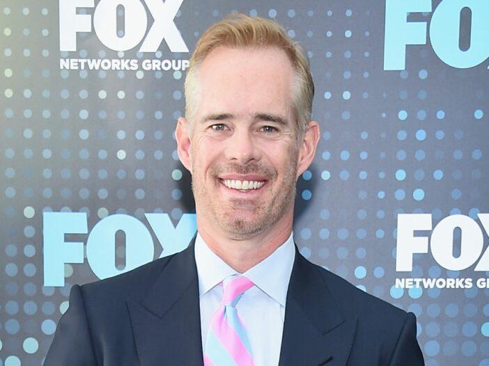 Joe Buck wears a dark suit at a FOX event