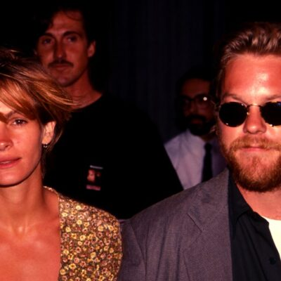 Julia Roberts and Kiefer Sutherland walk side by side in 1991