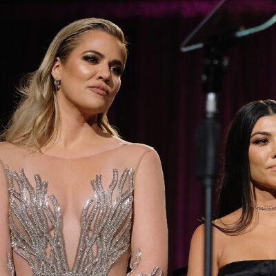 Khloe and Kourtney Kardashian stand onstage together
