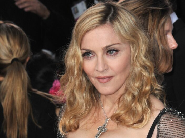 Madonna wears a silver dress with her hair loose on the red carpet