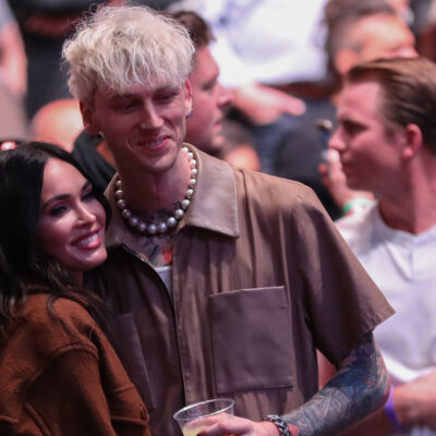 Megan Fox on the right, with her arm around Machine Gun Kelly at a UFC fight in April 2021.