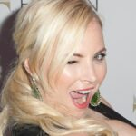 Meghan McCain wears a low cut black dress and winks playfully at the camera